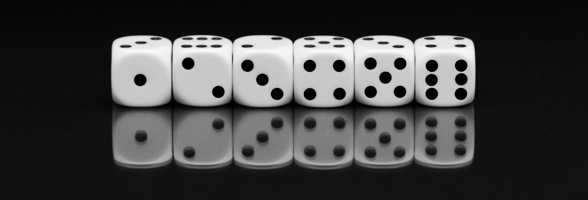 Image showing six dice in a line, numbered from 1-6, illustrating thet Mathematics examinations can be a game of chance without the right preparation.