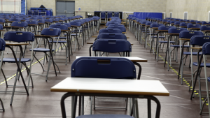 Image of an empty school examination hall in preparation for students to take an exam on a page for the benefits of Maths tuition
